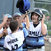 ROBERT GURECKI   -   DFM<br /> Aston Middletown's Sam Benvignati (9) is congratulated at home plate after hitting a home run against<br /> Taney in the second round of the Little League tournament played at Aston Middletown.