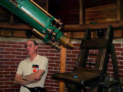 Visitor looks at the telescope.