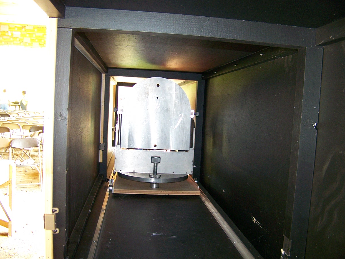 Here's a shot looking down the testing tunnel to where the telescope mirror you want to test would be. If you were polishing a telescope mirror you would place it within this chamber, face up towards us on edge, with the mirrors back vertical against the mirror stand shown. The stand has a knob to adjust the height of the mirror and it can also be adjusted from side to side so light coming down the tunnel from the Foucault tester will shine on it.