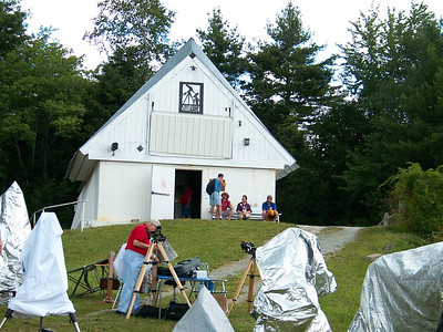 Poeple settin' up by the Schupmann telescope building.