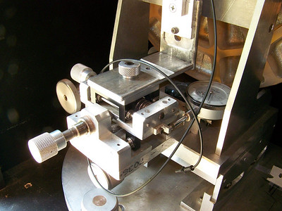 """Foucault Tester close up. Notice it uses a dial indicator and has what appears to be a """"precision slide"""". This device measures the longitudal shift in the traversing light & shadows that are visible on the tested optic."""