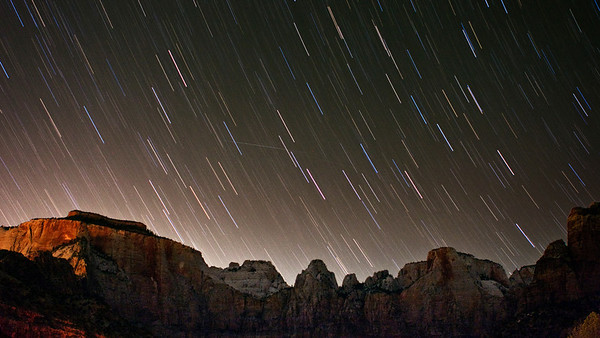 Star trails above West Temple, Sundial, and Alter of Sacrifice at Zion National Park, UT.  Added bonus meteor in center of image.