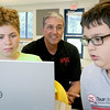 Former NASA astronaut Don Thomas listens to some ideas from Jalen Leider, 13, of Fitchburg and Logan McGarry, 12, of Gardner as they explains some of the ideas that their group came up with for experiments in space at the Boys and Girls Club this week. SENTINEL & ENTERPRISE/JOHN LOVE