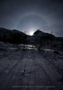 Moon Halo over Winter Landscape