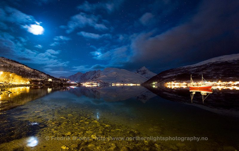 Moon and Venus shining over a Norwegian Fishing Village in the inner part of Kaldfjorden