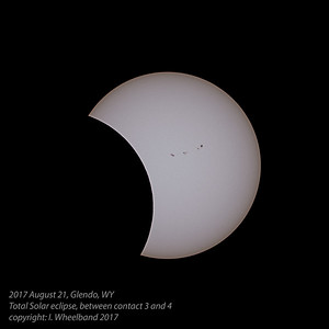 Partial phase in the latter stages of the eclipse, between 3rd and 4th contact.  The Sunspots that helped me focus on the Sun before the eclipse are revealed again as the Moon moves away from the Solar disc.  Thanks, sunspots.