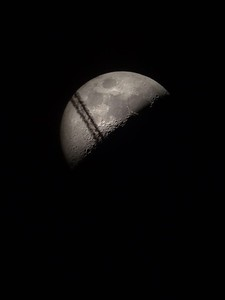 1st Quarter Moon and airplane contrails
