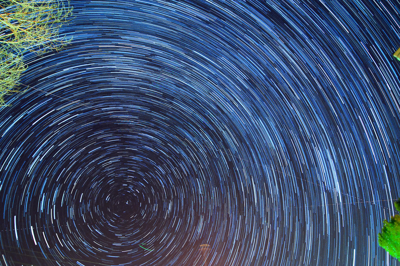 Polaris the North Star, exposure every 30 seconds for 43.5 minutes. Enhanced all 14bit RAW files in Photoshop, tungsten white balance, auto levels, then stitched together.