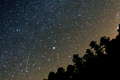 The 2010 Geminids peak night (December 13/14, 2010) at Deerlick Astronomy Village (DAV) in Georgia (U.S.A.)  Single 1 minute exposure, taken with the Canon 7D at ISO1600 and Canon 15mm f/2.8 Fisheye lens shows a bright Geminid passing in Canes Major.