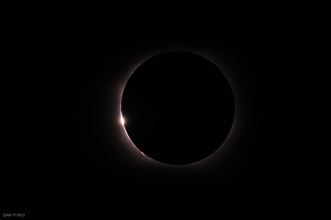 Third contact (end of totality).  As third contact happened, clouds began to move in and were visible in subsequent shots.  Note prominences visible (zoom in).