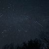 """This is a composite image of the Geminids meteor shower taken with my Canon 6D and a Rokinon 14mm lens at f2.8. I took hundreds of exposures over the night, all while tracking these stars. Then I picked all the shots with meteors in them and digitally added them together into Photoshop to create this image... a near """"all night"""" capture of 74 Geminids. This is a really wide view, covering most of the entire sky. The Milky Way is visible across several constellations... including Orion, Taurus and Perseus. All the meteors seem to radiate from a point in Gemini, an effect due to perspective. Those tiny meteors near the radiant point are ones seen coming nearly """"head on"""" to the camera.<br /> <br /> Taken on December 13/14 2017."""