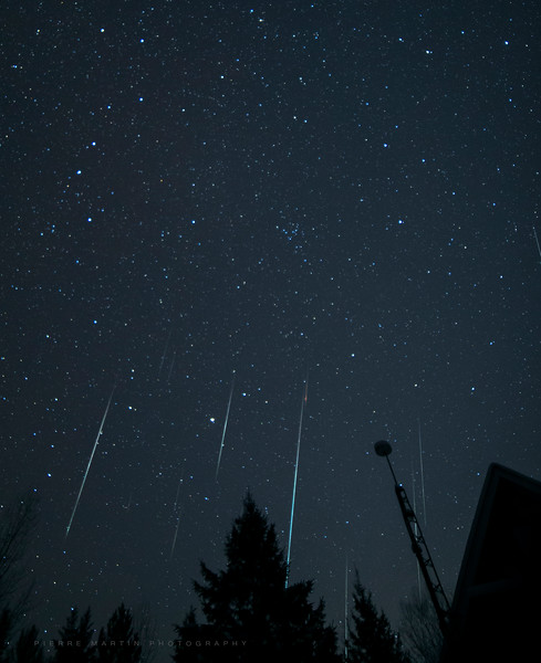This ia another composite image of the Geminids taken with my Canon 6D and a Rokinon 14mm lens at f2.8. This was towards the end of the night. Some bright long meteors were captured heading down to the east. The Big Dipper is visible on the top left, oriented vertically.