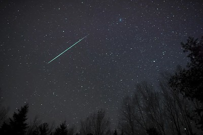 "Time lapse video of a Geminid fireball and its persistent train (looks like a brownish ""puff"" right behind the meteor). To see it better, go to the settings below and make sure that HD is selected! The real time sequence is 4.5 minutes (the meteor lasted about 1 second, and the glowing train lingered for much longer).  Canon 5D, Rokinon 24mm f.1.4 lens (set at f2.0)  Morning of December 14, 2017"