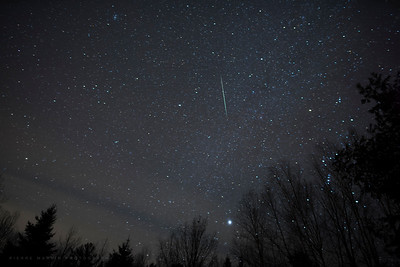Another single image of a Geminid. The grey bands at the bottom right is a slight haze that passed by.  Canon 5D, Rokinon 24mm f.1.4 lens (set at f2.0)  Morning of December 14, 2017