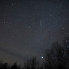 Another single image of a Geminid. The grey bands at the bottom right is a slight haze that passed by.<br /> <br /> Canon 5D, Rokinon 24mm f.1.4 lens (set at f2.0)<br /> <br /> Morning of December 14, 2017