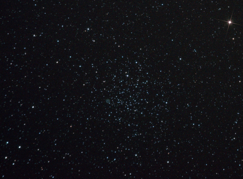 Messier M46- NGC2437 and NGC2438 - 3/12/2010<br /> <br /> A cropping of a wider field containing M46, M47 and Comet Hartley 2 (see separate uncropped image). Skyglow showing in background. Being near the edge of the field of the original image and having no field flattener, stars to the bottom left in particular are elongated.<br /> <br /> Star points created with electrical tape X in front of objective lens<br /> <br /> DeepSkyStacker 3.3.2 Stacked 80% of 9 Images ISO 800 180 Sec, 10 DARK, 10 BIAS, 0 FLATS, Post-processed by Photoshop CS5<br /> <br /> Telescope - Apogee OrthoStar LOMO 80/480 with Hotech SCA T-Adapter, Hutech IDAS LPS-P2 filter, Canon 400D DSLR, Ambient xxC (not recorded). Mount - Skywatcher NEQ6 Pro. Guidescope - Orion ShortTube 80 with Star Shoot Auto Guider.