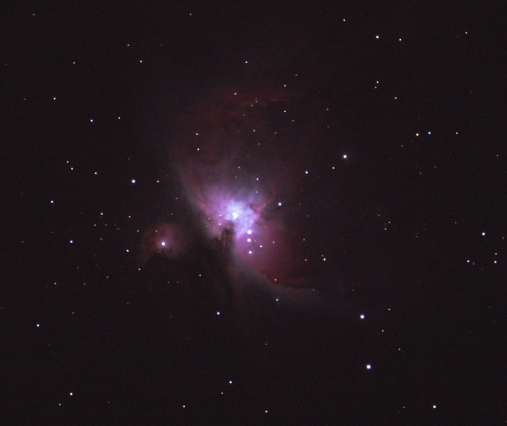 Messier M42 - NGC 1976 - Orion Nebula 01/10/2010 (Processed JPEG Stack)<br />  <br /> First 'stacked' and guided image of this most photographed of objects, 3 best of 5 images stacked using DeepSkyStacker 3.3.2 and cropped and colour adjusted by Adobe Photoshop CS5. Taken through the Apogee 80 on the SkyWatcher NEQ6 mount. Guided for 30sec @ISO 400 in-camera JPEG with no in-camera dark and with no light pollution filter or field flattener. <br /> <br /> Things to note in the processed image are the noticeable reduction in the level of noise in the background and hot red and blue pixels from the stacking process compared to the single shot of 5 nights earlier (26/09/2010), even with so few frames. The cropping has avoided the spherical aberration from the outer edges of the original image. Focused using a Bahtinov Mask. The 4 bright stars in the core, the trapezium, are over-exposed. Post processing has accentuated the colour and contrast a little but more exposure is required for finer details in the cloud and dust structure. These two conflicting points highligh one of the difficulties of imaging this object from core to tenuous extents. A definite HDR candidate if I ever master the technique, however even at this early stage this is better than my best image of 30 years earlier on film and with a much larger telescope!<br />  <br /> Telescope - Apogee OrthoStar LOMO 80/480 without Field Flattener or light polution filter, Canon 400D DSLR, Ambient xxC not noted. Mount - Skywatcher NEQ6 Pro. Guidescope - Orion ShortTube 80 with Star Shoot Auto Guider. Stark Labs PHD software used for guiding.