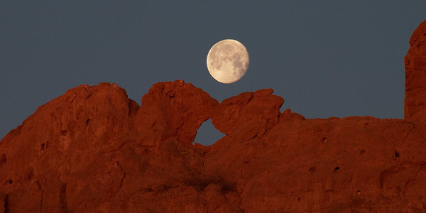 Full moon setting over the Kissing Camels in the Garden of the Gods.