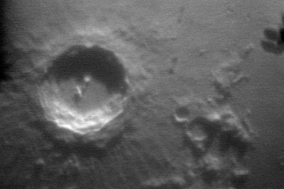 A close up of one of the moons craters.