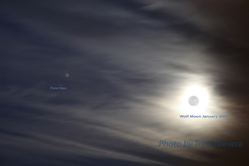 photoshop composite of the wolf moon with planet Mars