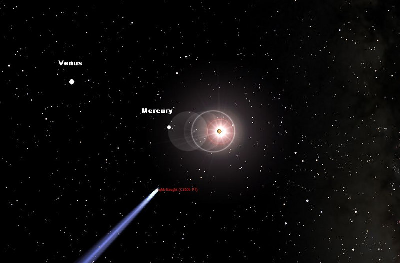 """The Comet as it asppears in the Daytime sky on Jan 16, 2007 at approx 1:30 pm. The sky has been make dark purposly to show that the planets Mercury & Venus are also nearby. Mercury is a bit over 5 degrees from the sun and Venus is approx. 19 degrees. The great comet is a scant 10.5 degrees from the sun on this date and time.   Note 10 degrees is just about a """"fist wide"""" held with your arm fully extended. I imputed the orbital elements into Starry Night Pro to obtain this image. ( North is up on this on all images here.)  Click on the above image to enlarge."""