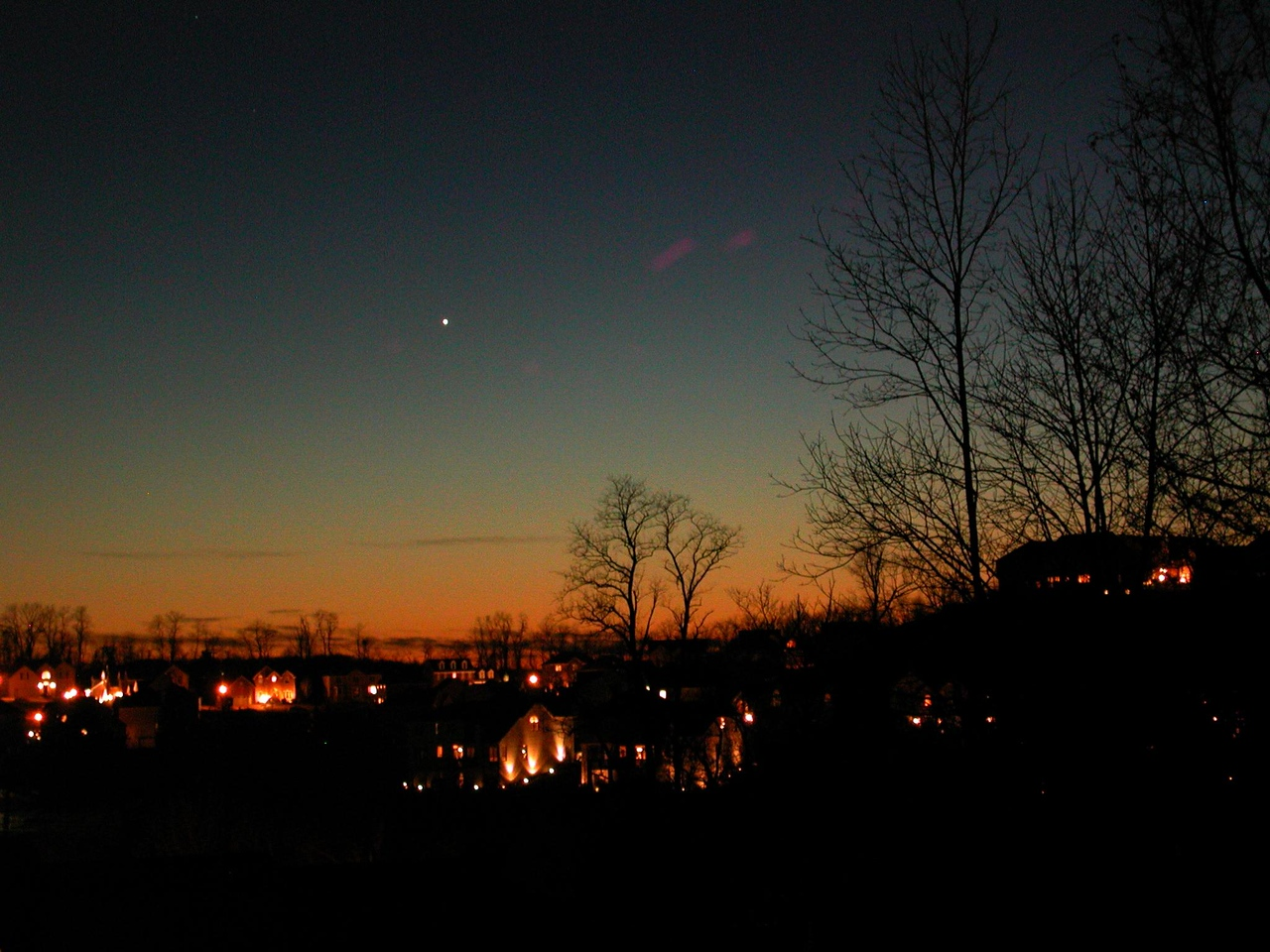 On Jan 17, 2006 I took this image in 26 degree weather of the planet Venus setting in the sunset fom a vantge point near my home; in South Park. On Jan 8, the comet was visible from this same area and dissappeared to the right of the big house that appears in the extream right hand side of this image. Goodbye great Comet...we will miss you!    Click on the next image for more great Comet McNaught images!!