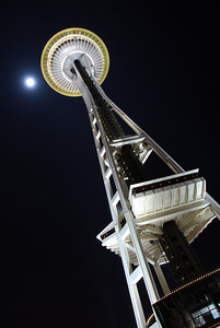 Moon flanking the Seattle Space Needle.
