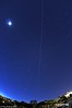 Moon at left and iridium flare at right. Long visibility and 15mm lens didn't even come close to getting it all.