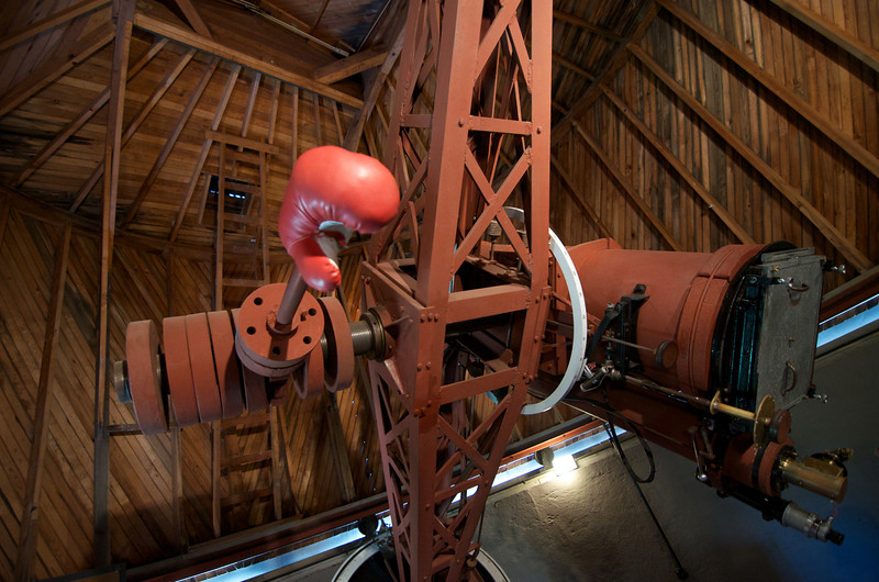 "Telescope used by Clyde Tombough who discovered Pluto.  Percival Lowell was instrumental in the discovery in so much as he believed in the existence of a ""planet X"" that  he believed explained the peculiarly perturbed orbit of Uranus.  In fact, the planet Percival thought existed lead serendipitously to the discovery of Pluto, a celestial body too small to explain Uranus's orbit."