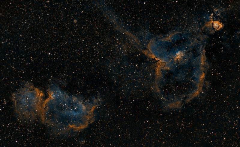 Heart and Soul nebula in narrowband Hubble colors. Taken with 200mm Canon lens @ f2.8 and ML8300 camera. Ha,OIII,SII each 3x30 minutes for total 4.5 hours exposure.  Taken by Lynn Hilborn March 31, April 5, 6 2012 at WhistleStop Obs,Grafton,Ontario.