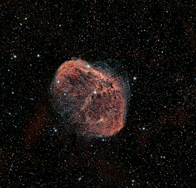 "Crescent Nebula NGC6888.  TEC140 @f7 ML8300 camera. Ha and OIII with RGB stars.<br /> RGB 12x5m each bin 2x2, Ha 9x30m bin 1x1, OIII 6x30m bin 1x1. <br /> Imaged and processed by Lynn Hilborn, WhistleStop Obs, Grafton,Ontario.<br /> <br /> Discovered in 1792 by Friedrich Wilhelm Herschel, the Crescent Nebula (NGC6888, Caldwell 27, LBN 203, Sharpless 105), also known as ""Van Gogh's Ear"" is a magnitude 7.40 emission nebula in the constellation Cygnus (The Swan). It is formed by the violently fast stellar winds emanating from a Wolf-Rayet star (WR 136, HD192163) colliding with the slower gases that were shed by the same star many thousands of years ago when it was a red giant. The gaseous shell is approximately 25 light-years across and 5,000 light-years distant. It is predicted that the central Wolf-Rayet star will eventually explode into a supernova in approximately 100,000 years."