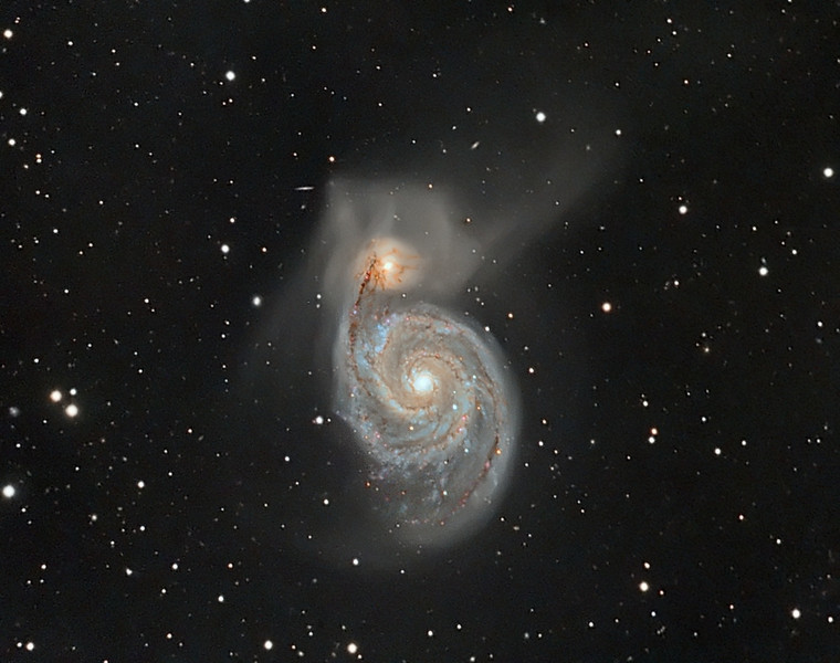 "M51 Whirlpool Galaxy  4 hours exposure LRGB  (130m L  40m each RGB) . Taken @ f 6.3 with C9.25 and FLI ML8300 camera. June 07, 2010 by Lynn Hilborn, Grafton, Ontario <br /> M51 (NGC 5194 and NGC 5195) (The Whirlpool Galaxy)<br /> <br /> Distance: 37 million light years<br /> <br /> text copyright Robert Gendler 2006<br /> <br /> M51 was the first spiral structure ever observed by Lord Rosse in 1850 at a time when the true nature of galaxies was unknown. Its undeniable beauty explains its recognition as a true showpiece of the night sky. Probably less appreciated is that M51 represents a dramatic demonstration of an interacting pair of galaxies. As truly immense structures, galaxies are relatively large compared to the average distance between them. Most galaxies are separated by a distance of only 20 times their diameter compared to stars which are separated by 10 million times their diameter. As a result most galaxies are likely to encounter other galaxies at least a few times over their immense lifetimes. The encounters run the gamut from ""major"" mergers involving the collision of two comparable mass galaxies to more ""minor"" mergers involving the consumption of a small companion or satellite galaxy by the more dominant galaxy.<br /> <br /> Astronomers currently believe that galaxy formation is an ongoing hierarchical process. The basic form of a galaxy is established early in its history as the galaxy emerged from its primordial cloud. Billions of years later galaxies continue to evolve even in the present time, through major and minor mergers. Collisions and mergers certainly occurred with greater frequency in the early universe but without question continue into the present epoch as we observe many galaxies in the local universe, such as the M51 complex, showing the strong signatures of ongoing interactions. When encounters happen, the close proximity of the massive structures set up powerful gravitational forces known as tides. As the galaxies move closer the enormous attractive forces act to dramatically and often violently alter the structures of both participants.<br /> <br />  <br /> <br /> The 51st entry in Messier's list actually represents 2 galaxies. NGC 5194 (also known as M51A) represents the magnificent spiral, while NGC 5195 (also known as M51B) is likely an irregular type dwarf galaxy now located behind the larger spiral galaxy.<br /> There have been many attempts to explain the morphology and evolution of the NGC 5194/5195 system including its apparent tidal bridges and grand design spiral shape. Classic papers by Toomre (1972), Howard (1990), and Rots (1990) have provided valuable insight into the evolution of the M51 complex and are summarized below.<br /> <br /> Simulations suggest that NGC 5195 is located well behind NGC 5194 and that the two galaxies are now traveling away from each other. The two galaxies had their closest recent approach some 70 million years ago, when the less massive NGC 5195 encountered the disk of NGC 5194 in a highly inclined passage. The effects of that interaction include several conspicuous disturbed features as well as a general brightening and strengthening of the inner spiral arms of NGC 5194. The disturbed features include the marked asymmetry of the spiral arms both near and far (north and south) in relation to the companion NGC 5195. The near arm appears thin and extended and the far arm fans out as an extended tidally disturbed structure. The extraordinary plumes that extend north, northwest, and southeast from the companion were likely torn from it as it engaged the more massive spiral in its recent encounter. The apparent spiral arm-bridge (northern arm) between the two galaxies is an illusion as NGC 5195 is far behind the NGC 5194, the near spiral arm being superimposed over the disk of NGC 5195 in the same line of sight. A visible area of intense star formation is conspicuous near the nucleus of NGC 5195 and was almost surely triggered from the time of the recent approach. Not all the disturbed features of the M51 complex are believed to be from the recent encounter. Radio surveys have detected an immense gas cloud with no optical counterpart that fans out along the eastern side of the M51 complex, extending some 300,000 light years in length and carrying about 500 million solar masses. It appears to be an extension of the optically apparent far spiral arm but is most likely an independent feature and a relic from a previous crossing that occurred as much as 400 million years ago.<br /> <br /> The ultimate fate of the M51 complex will likely be a gradual decay in the orbit of the companion (the orbital period now is about 500 million years with a major axis of about 50,000 light years) towards a final merger with the spiral and eventual tidal breakup of the companion in about 1 to 2 billion years."