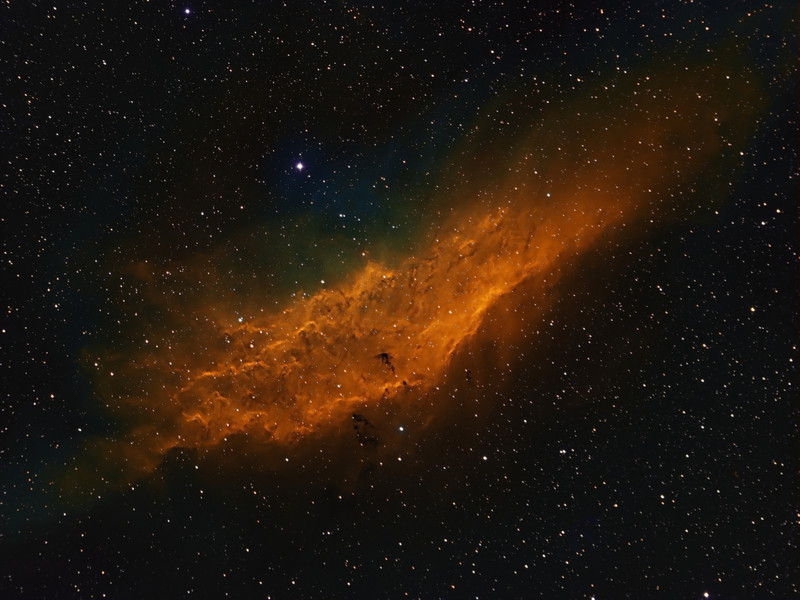 California Nebula...taken with Tokina 300mm lens f2.8. and FLI ML8300 camera. Narrowband image done in Hubble colors. ( Ha bin 1x1 5x30m, SII binned 2x2 6x30m, OIII binned 3x3 6x30m ). Taken by Lynn Hilborn Nov 21 - Dec 11, 2011 at Grafton, Ontario.