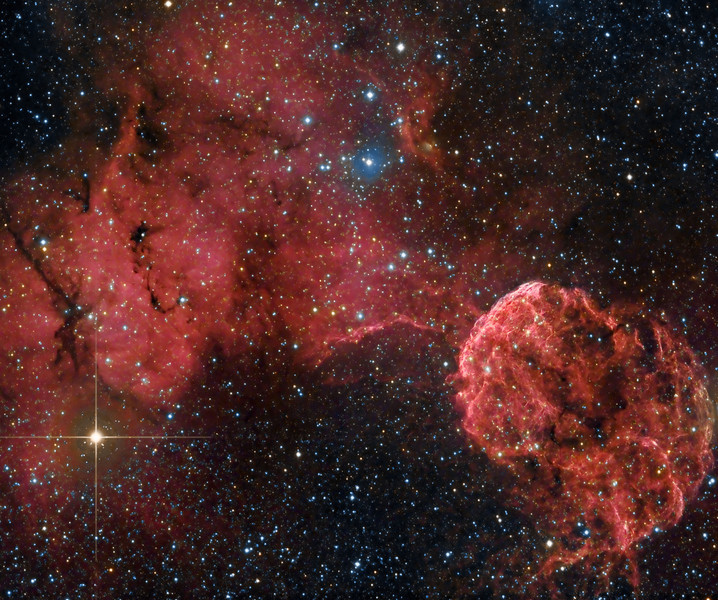 The Jellyfish nebula ( IC443 ). IC443 is a supernova remnant of a star which exploded about 35000 years ago. It is located approx. 5000 light years away. To the left is Sharpless 249, a large emission nebula, which also contains the small reflection nebula IC444( small blueish patch in the upper middle).  260 minutes Ha and 25 minutes each RGB taken over 2 nights March 17 and 18, 2010. NP101is @ f4.3 and FLI ML 8300 camera. Taken by Lynn Hilborn, Grafton, Ontario