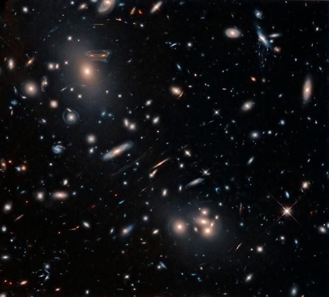 "Hubble Space Telescope data processed by Lynn Hilborn<br /> No, this is not a Salvador Dali painting, it is  galaxy cluster Abell 68 showing gravitational lens effect.<br /> Want to use a cluster of galaxies as a telescope? It's easier than you might think as distant galaxy clusters naturally act as strong gravitional lenses. In accordance with Einstein's theory of general relativity, the cluster gravitational mass, dominated by dark matter, bends light and creates magnified, distorted images of even more distant background galaxies. This sharp infrared Hubble image illustrates the case for galaxy cluster Abell 68 as a gravitational telescope.  Description from APOD see <a href=""http://apod.nasa.gov/apod/ap130308.html"">http://apod.nasa.gov/apod/ap130308.html</a><br /> <br /> Data from the Hubble Legacy Archive established by the Space Telescope Science Institute, the Space Telescope European Coordinating Facility and the Canadian Astronomy Data Centre."