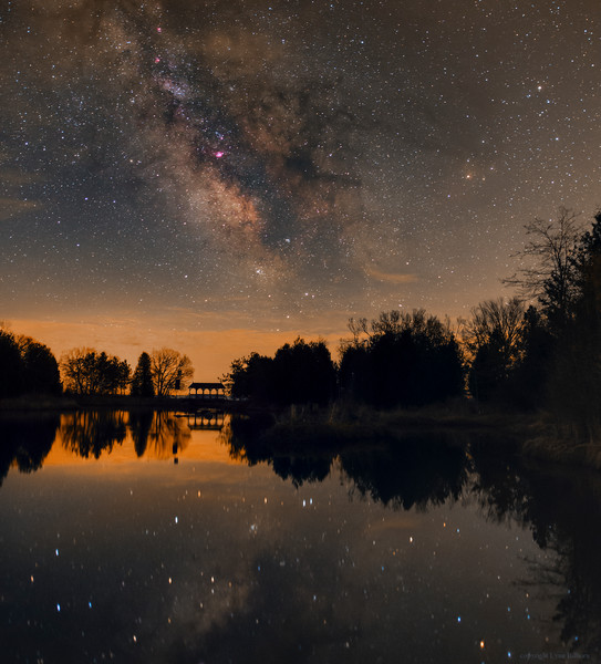 The Bridge between Stars<br /> <br /> Taken by Lynn Hilborn, April 16,2015 at Nauwatin Nature Preserve near Grafton, Ontario.<br /> Canon 6d modified and Sigma 24mm f1.4 ART lens at f2.0, 1600 ISO a single 20 second exposure on a tripod.