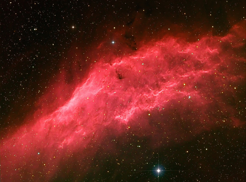 California Nebula NGC 1499<br /> Drifting through the Orion Arm of the spiral Milky Way Galaxy, this cosmic cloud by chance echoes the outline of California on the west coast of the United States. Our own Sun also lies within the Milky Way's Orion Arm, only about 1,500 light-years from the California Nebula. Also known as NGC 1499, the classic emission nebula is around 100 light-years long. It glows with the red light characteristic of hydrogen atoms recombining with long lost electrons, stripped away (ionized) by energetic starlight. In this case, the star most likely providing the energetic starlight is the bright, hot, bluish Xi Persei, just near the nebula and at the bottom of picture center. (Text adapted from Astronomy Picture of the Day)<br /> ..5 hours of Ha (20m x 9 and 15m x 8) binned 1x1, 2x10m each RGB binned 2x2.<br /> NP101is @ f4.3 and FLI ML8300 camera. Taken on March 7 and 8, 2010 by Lynn Hilborn at WhistleStop Obs, Grafton, Ontario.