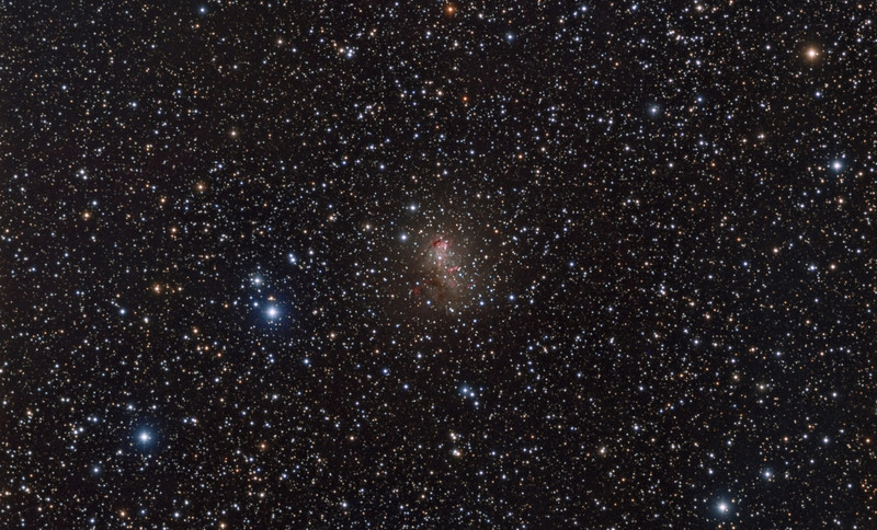 Irregular Galaxy IC10 taken by Lynn Hilborn, WhistleStop Obs, Grafton,Ontario on August 28,29 and September 3,2013.<br /> TEC140 @f5.3 and FLI ML8300 camera.Lum 1x1  29x10m , RGB  2x2 9x10m each, Ha 2x2  6x30m.<br />  Lurking behind dust and stars near the plane of our Milky Way Galaxy, IC 10 is a mere 2.3 million light-years distant. Even though its light is dimmed by intervening dust, the irregular dwarf galaxy still shows off vigorous star-forming regions that shine with a telltale reddish glow in this colorful skyscape. In fact, also a member of the Local Group of galaxies, IC 10 is the closest known starburst galaxy. Compared to other Local Group galaxies, IC 10 has a large population of newly formed stars that are massive and intrinsically very bright, including a luminous X-ray binary star system thought to contain a black hole. Located within the boundaries of the northern constellation Cassiopeia, IC 10 is about 5,000 light-years across. Text from APOD Astronomy Photo of the Day.