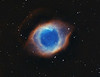 Helix Nebula 'Eye of God'. Taken with TEC140 @f5.6 and FLI ML8300 camera. 30 minute sub frames, Ha 5x30m, OIII 5x30m all binned 1x1. Taken by Lynn Hilborn, August 29 and Sept 07, 2011 at WhistleStop Observatory, Grafton, Ontario. Object only reached 20 degrees above the horizon.<br />  Published in Sky and Telescope magazine (March 2012) and SkyNews magazine (January 2012).
