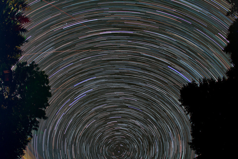 Star trails, Iridium flare, planes and fireflies...over the observatory. 100x45 seconds Canon 60D and Sigma 10mm f2.8 lens.  Taken by Lynn Hilborn, June 22, 2012.