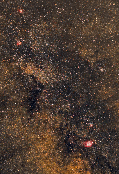 From Lagoon Nebula (bottom) to Trifid,to Omega, to Eagle (top). Canon 135mm f2 lens at f2.5 and Canon 6d modified.<br /> 22 frames 4 minutes each at 1600 ISO. Taken by Lynn Hilborn June 16, 2015 at WhistleStop Observatory, Grafton,Ontario.