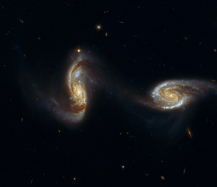 Arp 240 interacting galaxies....Hubble Space Telescope data from the Hubble Legacy Archive processed by Lynn Hilborn, March 27,2013.<br /> NGC 5257/8 (Arp 240) is an astonishing galaxy pair, composed of spiral galaxies of similar mass and size, NGC 5257 and NGC 5258. The galaxies are visibly interacting with each other via a bridge of dim stars connecting the two galaxies, almost like two dancers holding hands while performing a pirouette. Both galaxies harbor supermassive black holes in their centers and are actively forming new stars in their disks. Arp 240 is located in the constellation Virgo, approximately 300 million light-years away, and is the 240th galaxy in Arp's Atlas of Peculiar Galaxies. With the exception of a few foreground stars from our own Milky Way all the objects in this image are galaxies.<br /> Data from the Hubble Legacy Archive established by the Space Telescope Science Institute, the Space Telescope European Coordinating Facility and the Canadian Astronomy Data Centre.