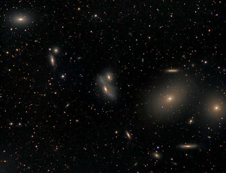 Markarian's Chain with galactic cirrus.... TEC140 @f5.3, FLI ML8300 camera with Baader filters on Tak NJP mount. Taken by Lynn Hilborn, WhistleStop Obs, Grafton, Ontario on April 1 and April 2, 2014.<br /> 4 hours of luminance with 10m exposures binned 1x1, and 3 hours RGB, one hour each 5 min exposures bin 2x2.