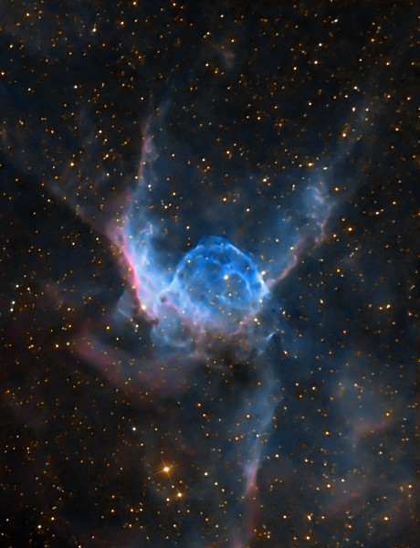 Thor's Helmet by Lynn Hilborn - Whistlestop Observatory, Grafton Ontario. (Photo appeared in March/April 2011 SkyNews magazine).<br /> This helmet-shaped cosmic cloud with wing-like appendages is popularly called Thor's Helmet. Thor's Helmet is about 30 light-years across. In fact, the helmet is actually more like an interstellar bubble, blown as a fast wind from the bright, massive star near the bubble's center sweeps through a surrounding molecular cloud. Known as a Wolf-Rayet star, the central star is an extremely hot giant thought to be in a brief, pre-supernova stage of evolution. Cataloged as NGC 2359, the nebula is located about 15,000 light-years away in the constellation Canis Major. (Text adapted from Astronomy Picture of the Day)<br /> <br /> 3 hours of Ha, 4x5m RGB each, all binned 2x2.  Shot at f10, C9.25 and ML8300 camera. February 6 and 7, 2010.