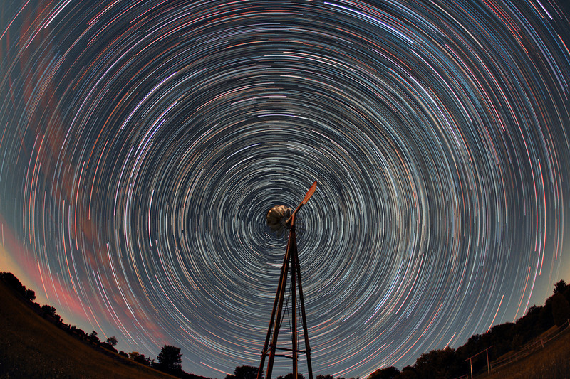 The world revolves around Shelter Valley...Shelter Valley Folk Festival star trails. 95 x 1 minute each, Canon 60D sigma 10mm lens @ f2.8, 1000 ISO. Taken by Lynn Hilborn, Grafton, Ontario on June 26, 2012. Picture appeared in November 2012 SkyNews magazine