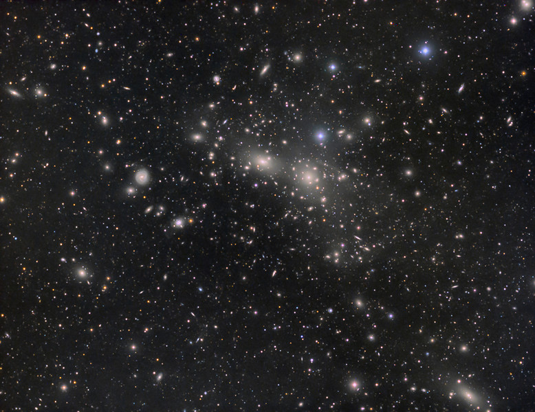 Abell 1656 Coma Cluster of galaxies surrounded by IFN (intergalactic flux nebula). Taken by Lynn Hilborn, WhistleStop Obs,Grafton, Ontario on April 23,24,26,2014.<br /> TEC 140 @f5.3 and FLI ML8300 camera with Baader filters on Takahashi NJP Temma2 mount.<br /> Lum 1x1 23x10m, RGB each 2x2 9x5m. The inverted view (next image) shows a 21.0 mag  quasar QSO HB89.<br /> <br /> The Coma Cluster (Abell 1656) is a large cluster of galaxies that contains over 1,000 identified galaxies. Along with the Leo Cluster (Abell 1367), it is one of the two major clusters comprising the Coma Supercluster.  It is located in and takes its name from the constellation Coma Berenices.<br /> <br /> The cluster's mean distance from Earth is 99 Mpc (321 million light years). Its ten brightest spiral galaxies have apparent magnitudes of 12–14 . The central region is dominated by two giant elliptical galaxies: NGC 4874 and NGC 4889. The cluster is within a few degrees of the north galactic pole on the sky. Most of the galaxies that inhabit the central portion of the Coma Cluster are ellipticals. Both dwarf, as well as giant ellipticals, are found in abundance in the Coma Cluster.<br /> <br /> As is usual for clusters of this richness, the galaxies are overwhelmingly elliptical and S0 galaxies, with only a few spirals of younger age, and many of them probably near the outskirts of the cluster.<br /> <br /> The full extent of the cluster was not understood until it was more thoroughly studied in the 1950s by astronomers at Mount Palomar Observatory, although many of the individual galaxies in the cluster had been identified previously.<br /> <br /> An extended X-ray source centered at 1300+28 in the direction of the Coma cluster of galaxies was reported before August 1966. This X-ray observation was performed by balloon, but the source was not detected in the sounding rocket flight launched by the X-ray astronomy group at the Naval Research Laboratory on November 25, 1964. A strong X-ray source was observed by the X-ray observatory satellite Uhuru close to the center of the Coma cluster and this source was suggested be designated Coma X-1.<br /> <br /> The Coma cluster contains about 800 galaxies within a 100 x 100 arc-min area of the celestial sphere.<br /> <br /> Text from Nasa