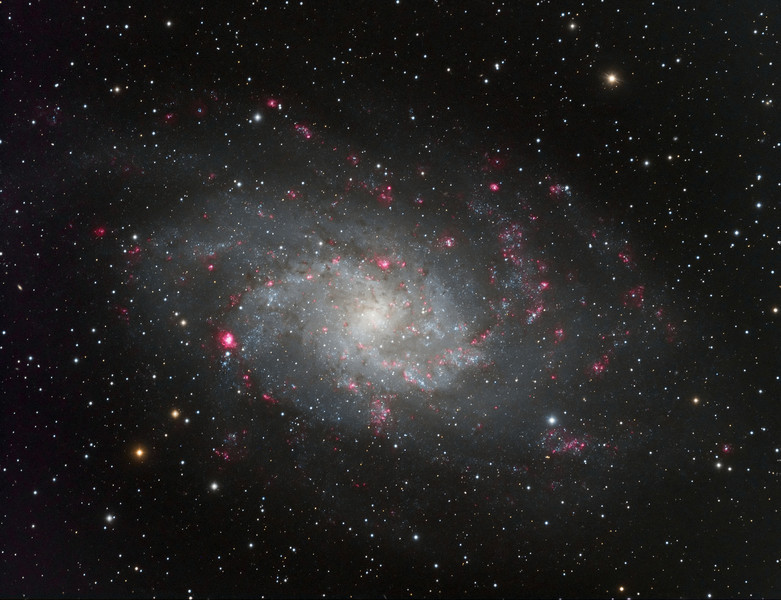 M33, the Triangulum Galaxy. The small, northern constellation Triangulum harbors this magnificent face-on spiral galaxy, M33. Its popular names include the Pinwheel Galaxy or just the Triangulum Galaxy. M33 is over 50,000 light-years in diameter, third largest in the Local Group of galaxies after the Andromeda Galaxy (M31), and our own Milky Way. About 3 million light-years from the Milky Way, M33 is itself thought to be a satellite of the Andromeda Galaxy (courtesy of APOD)<br /> Taken by Lynn Hilborn, November 2010. TEC 140 @f7 and ML8300 camera LRGB + Ha .