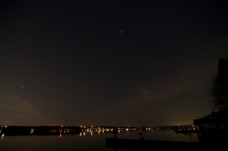 View of Skaneateles lake from the boat launch.  The water was so calm that you could see the reflection of stars in it.