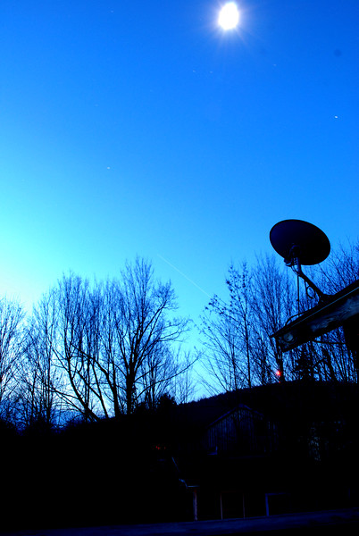 November 11, 2011 6:15am - passing of ISS in timed exposure. That is moon in sky. Image darkened to accentuate ISS trail (look in between trees mid-picture)