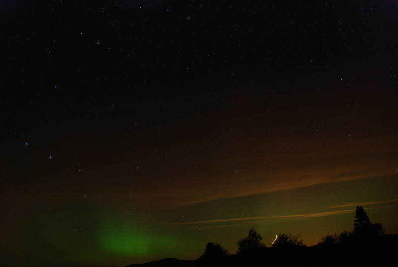 Taken 9/26/11 south of Gabriels looking northward. The green is the aurora borealis. Horizontal red/orange are mainly ground lights reflecting off clouds. Exposures between 1-2 seconds. An airplane can also be seen near the horizon in this shot